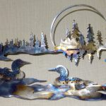 Dan Lee metal wall art at Kelley Gallery Art & Frame in Woodbury, MN