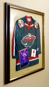 Framed Shania Twain signed MN Wild Jersey at the Xcel Center by Kelley Gallery Art & Frame in Woodbury, MN